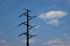 High-pressure pole under the blue sky Royalty Free Stock Image