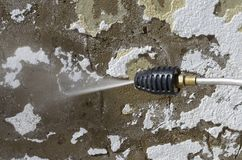 Power washing walls. High pressure Power washer removing loose paint Royalty Free Stock Image