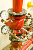 High pressure valve. Industrial high pressure valve and taps for a fire extinguishing system. Pressure gauges are showing water pressure royalty free stock image