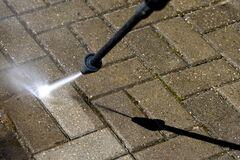 Free High-pressure Washer Cleaning Concrete Stones Of Garden Line In Country House Royalty Free Stock Photos - 189013998