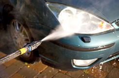 High pressure washer used on car Stock Photography