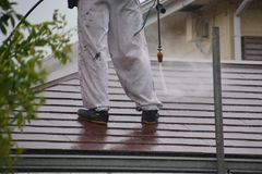 High-pressure washing of roof royalty free stock images
