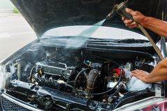 High pressure water cleaning car engine. Car washing cleaning engine,Cleaning car using high pressure water,High pressure water cleaning car engine Stock Images