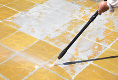 High pressure water - Cleaning. Worker is cleaning anexternal floor with a high pressure water Royalty Free Stock Image