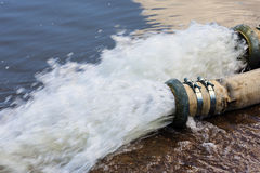 Water flows from the pipe Royalty Free Stock Image