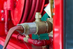 High pressure water pump valve with fire hose to cabinet Stock Image