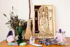 Free High Priestess From The Tarot Major Arcana With Broom, Candle And Crystals Stock Photo - 143010650
