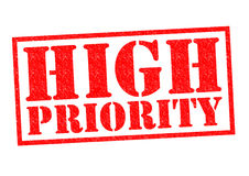 HIGH PRIORITY. Red Rubber Stamp over a white background Stock Image
