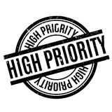 High Priority rubber stamp. Grunge design with dust scratches. Effects can be easily removed for a clean, crisp look. Color is easily changed Stock Photography