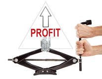 High profit. Car jack with arrow up and note Profit Stock Photo