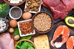 High protein food - fish, meat, poultry, nuts, eggs and vegetables. healthy eating and diet concept. Top view Stock Images