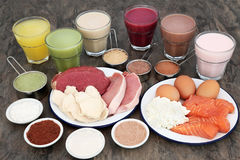 High Protein Food with Health Drinks. High protein food for body builders of meat, fish and dairy with supplement powders and health drinks Royalty Free Stock Photography