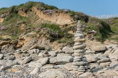 High Pyramid of stones on the sea. Pyramid of stones on the sea stock photography