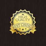 High Quality Best Choice Stamp Golden Label Reward. Award vector illustration in black and gold colors with stars isolated on wooden background Royalty Free Stock Photos