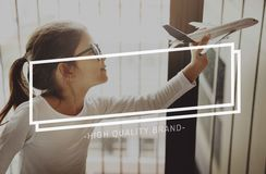 High Quality Brand Marketing Business Branding Copy Space Concept. A little girl plays with her airplane toy stock image