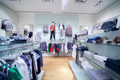 High-quality childhood clothes are in shop. High-quality childhood clothes are in empty shop Royalty Free Stock Image