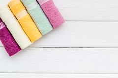 Bath accessories made of cotton set with towels on white wooden background top view mockup royalty free stock photography