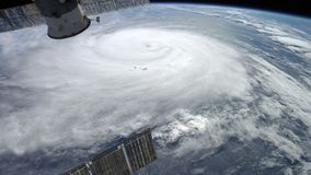 Satellite over a hurricane. High quality 3D render of a satellite over a hurricane stock video