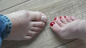 High-quality flooring. Men's and women's feet dancing on the wooden floor. Barefoot in the nice and beautiful parquet floor. High-quality flooring stock video footage