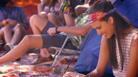 In high quality format carefree hipster sending text message. At a music festival stock footage