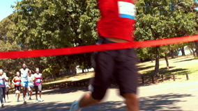 In high quality format fit people running race in park stock footage