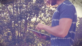 In high quality format handsome hipster using his tablet pc stock footage