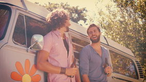 In high quality format hipster friends toasting with beers. On a summers day stock video