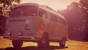 In high quality format retro camper van in a field. On a summers day stock footage