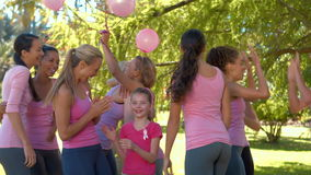 In high quality format smiling women in pink for breast cancer awareness stock video