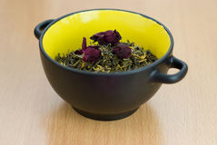High Quality Green Tea closeup with dry roses Stock Image