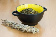 High Quality Green Tea closeup in the yellow bowl Stock Images
