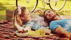 In high quality 4k format cute couple having a picnic
