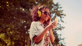 In high quality 4k format pretty hipster using her smartphone stock video