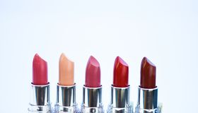 High quality lipstick. Daily make up. Cosmetics artistry. Lipstick for professional make up. Pick color which suits you. Compare makeup products. Lip care royalty free stock image