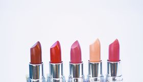 High quality lipstick. Daily make up. Cosmetics artistry. Lipstick for professional make up. Pick color which suits you. Compare makeup products. Lip care stock photo