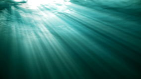 High quality Looping animation of ocean waves from realistic underwater. Light rays shining through stock video footage