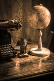 High quality old style writing table. Old style writing table with typewriter and globe Royalty Free Stock Images