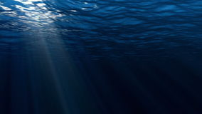 High quality perfectly seamless loop of deep blue ocean waves from underwater background. Light rays shining through, high definition 4k stock footage