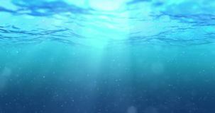 High quality perfectly seamless loop of deep blue ocean waves from underwater background with micro particles flowing. Light rays shining through stock video footage