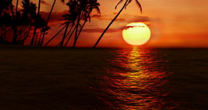 High quality perfectly seamless loop of sea ocean waves movement on sunset with palm island in background stock video footage