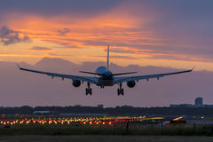 High quality picture of a plane landing before sunrise. Stock Images