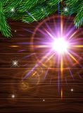 High Quality realistic poster for Christmas. Realistic fir branches on the background of dark wooden planks. Bright glow effects l. Enses. Vector illustration Stock Images