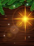 High Quality realistic poster for Christmas. Realistic fir branches on the background of dark wooden planks.. Bright lens effect glow. Vector illustration Stock Image
