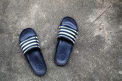 High Quality Rubber Sandal on the Concrete Floor. Royalty Free Stock Images