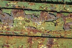 Rusty aged grunge green metal surface texture in poor condition royalty free stock photos