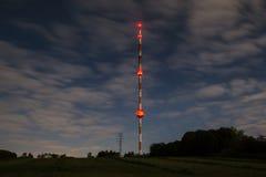 High radio tower at night Stock Photo