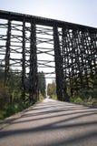 High railway bridge made of wooden typesetting logs Stock Photos