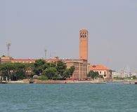 High red brick Bell Tower on the island of Sant'Elena in Venice Stock Photo