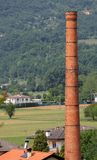 High red brick smokestack of an old factory Stock Images