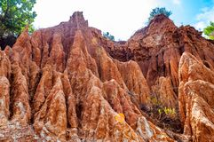 Free High Red Clay Rocks And Cliffs Washed By Winter Rains And Surface Water Flows. Clay Quarry, Mines Landscape Scene In Cilento And Royalty Free Stock Photos - 165580238